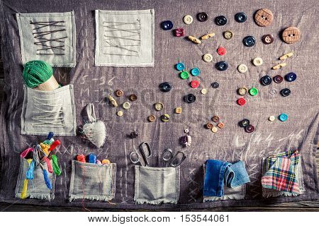 Background Made Of Threads, Needles And Buttons In Tailor Workshop