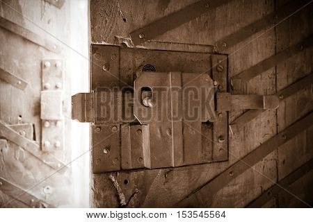 Old keyhole on a wooden door - concept image