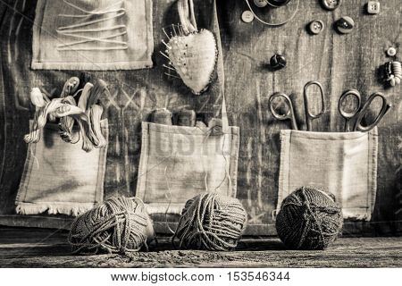 Vintage Background Made Of Threads, Needles And Buttons In Tailor Workshop