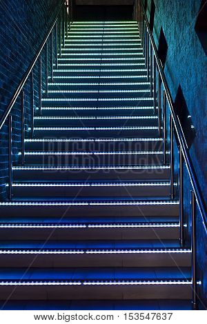 between the floors staircase with illuminated steps