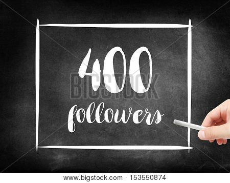 400 followers written on a blackboard