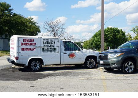 BOLINGBROOK, ILLINOIS / UNITED STATES - SEPTEMBER 17, 2016: The Bismillah Supermarket and Restaurant has a truck for catering and delivery.