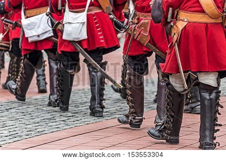 Background with medieval soldiers that marched on the street.