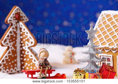 Christmas card with gingerbread house and tree with decorations