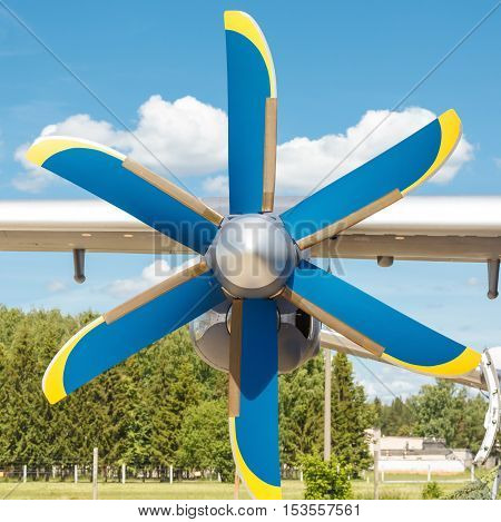 propeller of turboprop engine on a light cargo plane up on background of sky