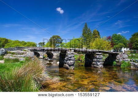 The ancient clapper bridge at Postbridges in Dartmoor National Park Devon England UK