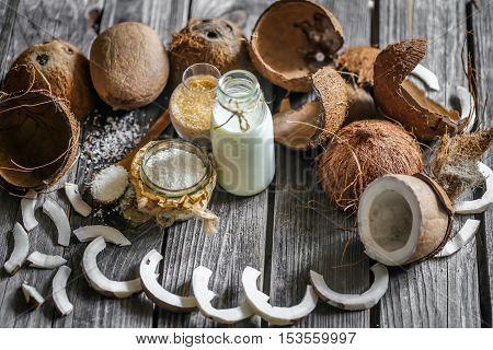 Fresh Coconuts Broken On Wooden Background