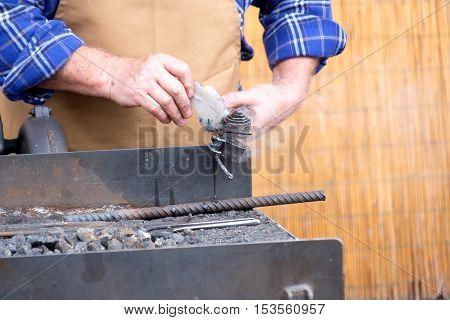 hot iron working handwork handmade metal blacksmithing