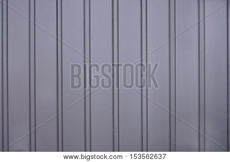 Siding, metal panels texture closeup in the daytime outdoors