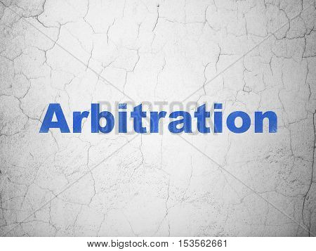 Law concept: Blue Arbitration on textured concrete wall background