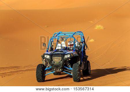 Merzouga, Morocco - Feb 22, 2016: Blue Polaris Rzr 800 And Pilot In Morocco Desert Near Merzouga. Me