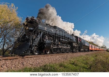 CHANHASSEN MN - OCTOBER 9 2016: The Milwaukee Road #261 steam train on its Fall Colors Tour from Minneapolis MN to Winthrop MN. This line has not had regular passenger trains traffic since 1960.