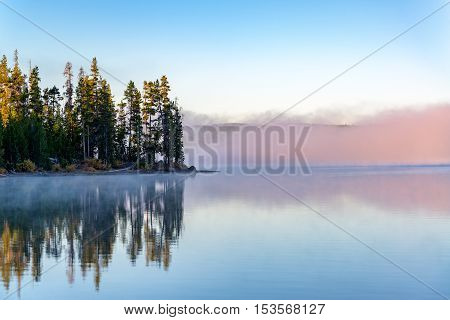 Early Morning Fog On A Lake