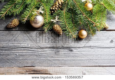 Christmas Background. Green Fir With Pine Cones, Gold Snowflakes, Ball