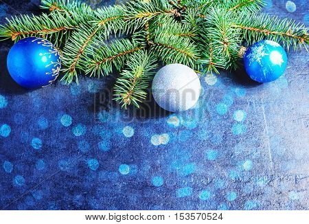 Branch Of A Christmas Tree And Blue Ball