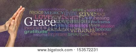 Saying Grace Prayer Hands - female hands in prayer position with the word GRACE in white surrounded by a wide multicolored word cloud on a rustic dark stone effect background