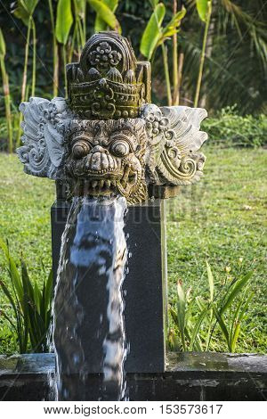 sculpture of a deamon in the Jungle of Ubud in Bali Indonesia Mandapa