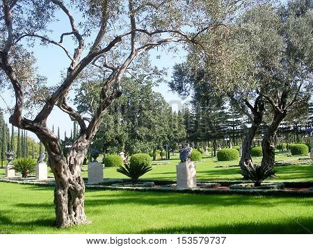 Sculptures in the trees in Bahai garden near Akko Israel November 17 2003