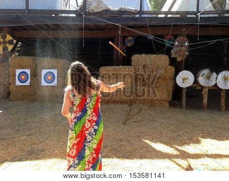 A Woman Throws a Spear at a Target during the Viking Festival