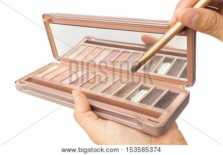 Women hand hold makeup brush and makeup cheeks for beauty concept