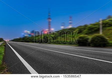 empty asphalt road by shanghai bund,china.