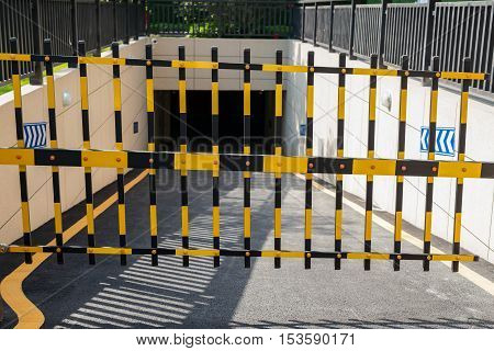 Vehicle security barrier closed - entrance to an underground car park