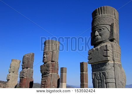 Toltec warriors columns topping the pyramid of Quetzalcoatl in Tula, mesoamerican archaeological site, Mexico