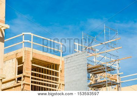Top of new condo building with scaffoldings for construction on side
