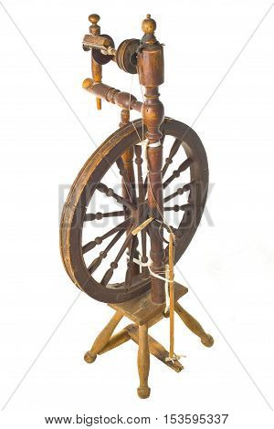 Old antique vintage traditional spinning-wheela distaff of the 19th century isolated on white background. Russia.