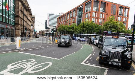 Manchester United Kingdom - September 24 2016: Urban landscape of Manchester city with black taxi cabs waiting for passengers in United Kingdom.