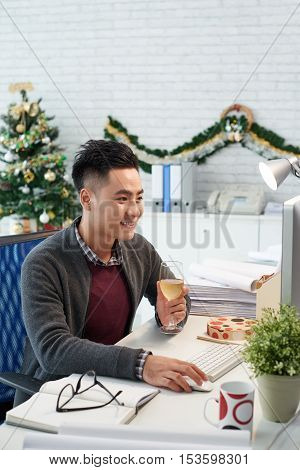 Vietnamese businesman working in office on Christmas eve