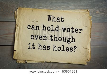 Traditional riddle. What can hold water even though it has holes?