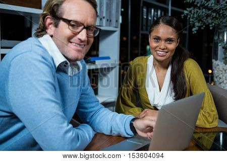 Portrait of business executives working in office at night