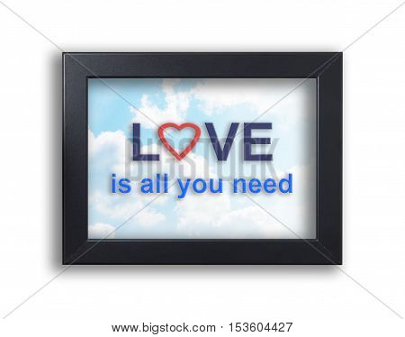 Love is all you need text on a sky background frame. Valentines love sky banner on black photo frame. Love with heart symbol on sky background.