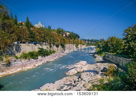 View of Bagrati Cathedral (Cathedral of Dormition) on the bank of Rioni river in Kutaisi, Caucasus region, Georgia , Europe.
