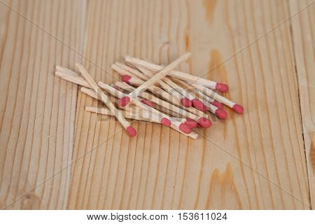 Red Matchsticks over on wooden table background