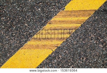 Yellow Dividing Line With Tire Tracks