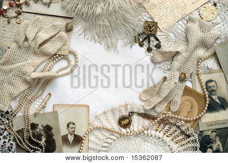 Vintage bordering with white crocheted gloves