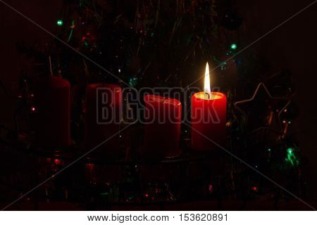 1. Advent / Advent wreath on dark background. Postcard.