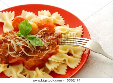 Farfalle on red plate