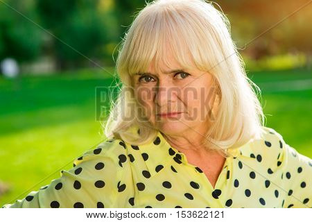 Lady with displeased face. Portrait of older female. Prejudice and expectations. I trust no one.