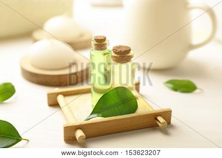 Spa composition with tea tree oil on white background