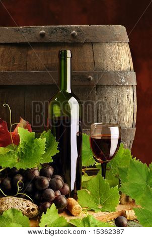Red wine with grapevine and cask