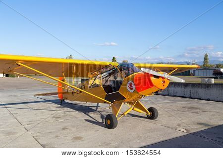 Bremgarten, Germany - October 22, 2016: A classic yellow Piper Cub aircraft parked at the airport