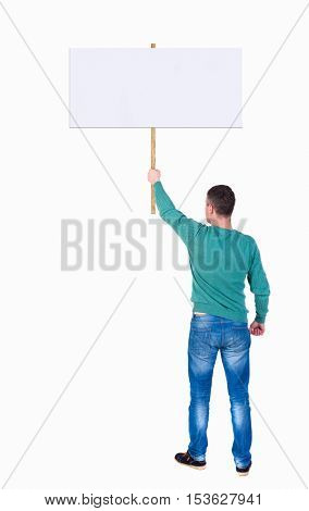 Back view man showing sign board. man holds information plate. Rear view people collection. backside view of person. Isolated over white. man in the green jacket holding big poster in her right hand