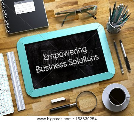 Empowering Business Solutions - Text on Small Chalkboard.Small Chalkboard with Empowering Business Solutions. 3d Rendering.
