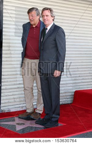 LOS ANGELES - OCT 25:  Stephen Fry, Hugh Laurie at the Hugh LaurieHollywood Walk of Fame Star Ceremony at the Hollywood Blvd. on October 25, 2016 in Los Angeles, CA