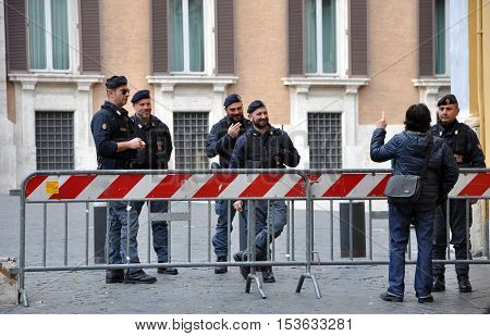 ROME ITALY - MARCH 17 2016: Italian police carabinieri standing in the front of the Palazzo Montecitorio in Rome the seat of the Italian Chamber of Deputies
