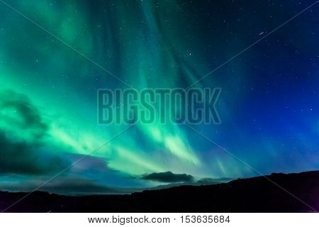Aurora at night over the land as a background