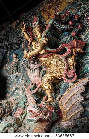 Statue of Kuixing god of fate at western hills, Yunnan, China